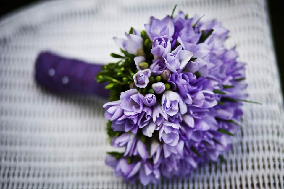 Seasonal Blooms - purple lavender flower bouquet on white chair Seasonal Blooms