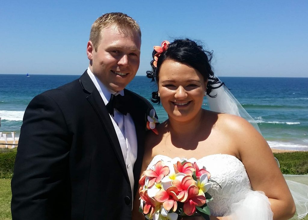 Greg & Sabrina on their wedding day - beach wedding outdoor clear blue skies