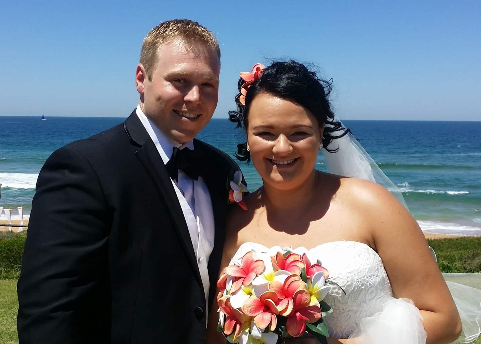 Greg & Sabrina on their wedding day - beach wedding outdoor clear blue skies