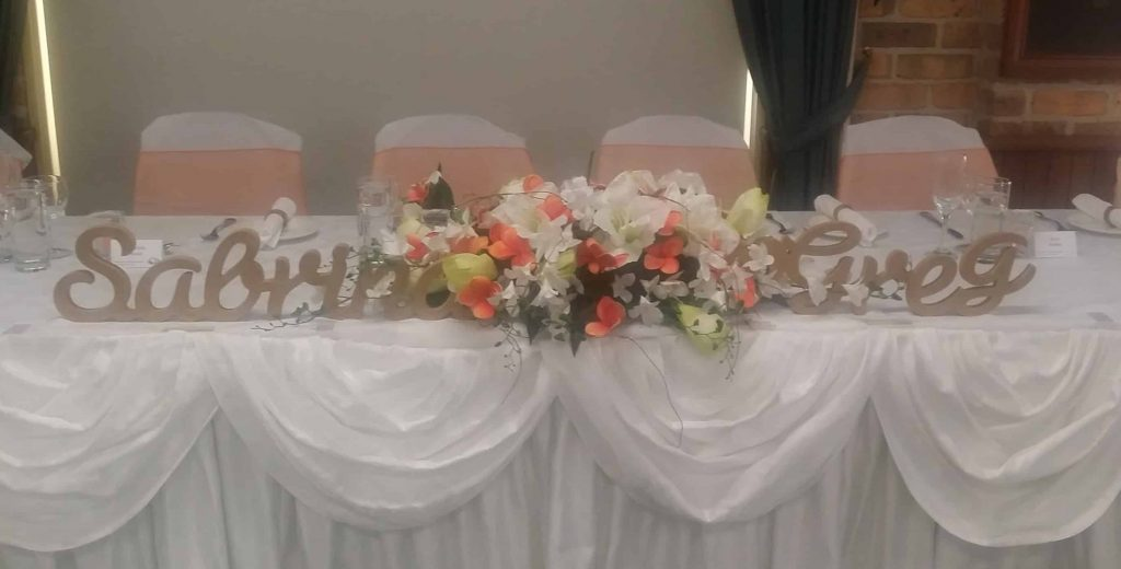 Sabrina & Greg Bridal Table Orange Chair Covers Floral Centrepiece