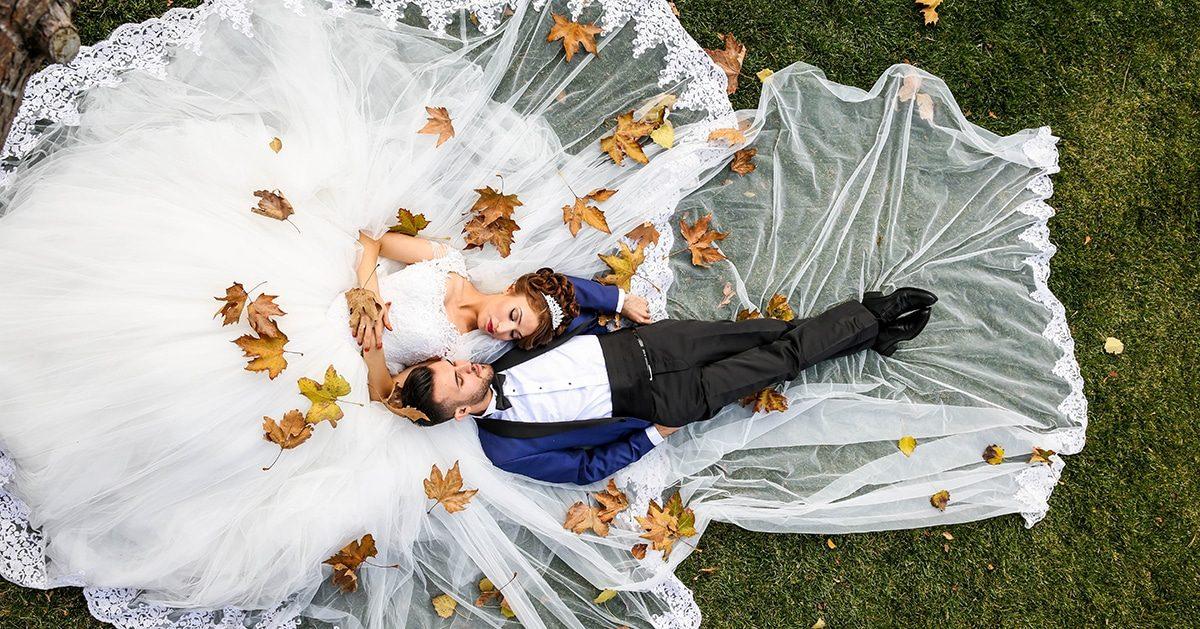 Bride Groom lying down in park Winter Wedding