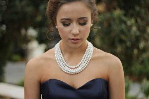 Woman Wearing Peal Necklace 30th wedding anniversary gift meaning