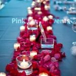 Red rose petals with candlesWM