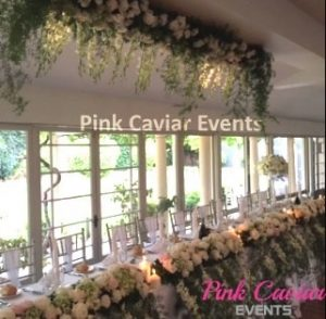 hanging florals above bridal table WM TO BE REPLACED