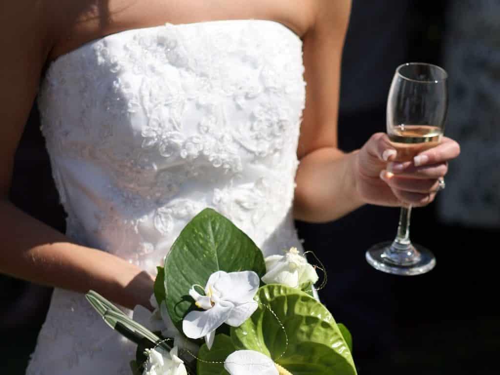 Wedding Cocktails: Bride Drinking Cocktail Champagne