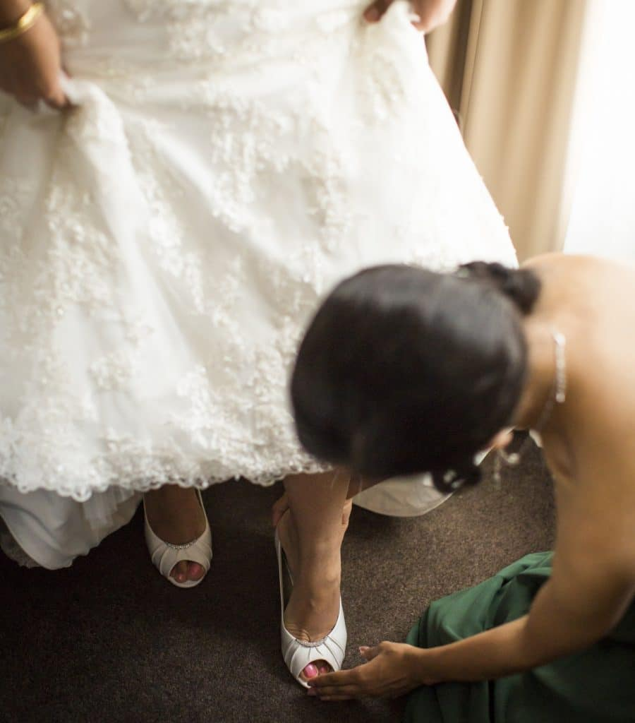 Maid Of Honour Duties Helping Put On Shoes Matron Of Honour
