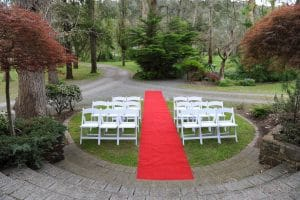 Wedding Ceremony White Chairs and Red Carpet