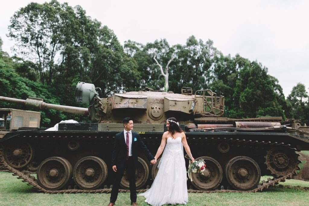 Alternative Wedding Transport Tank Wedding Bride Groom Holding Hands