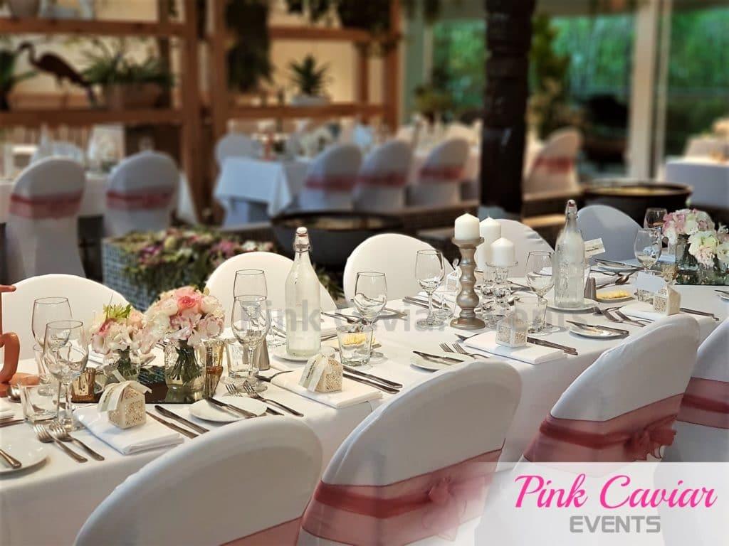 Garden Wedding Set up Silver Candle Sticks Pink Chair Sashs