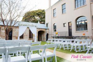 White Wedding Arch outdoor wedding ceremony WM CHECKED