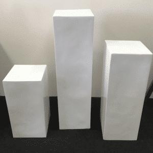 White pedestal plinths