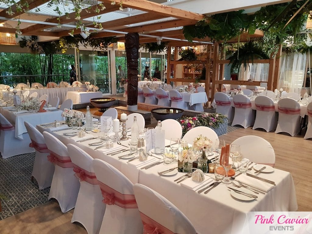Pink sash chair covers indoor garden wedding reception with silver stick candle holders An Evening Pack Down Service Wedding Styling