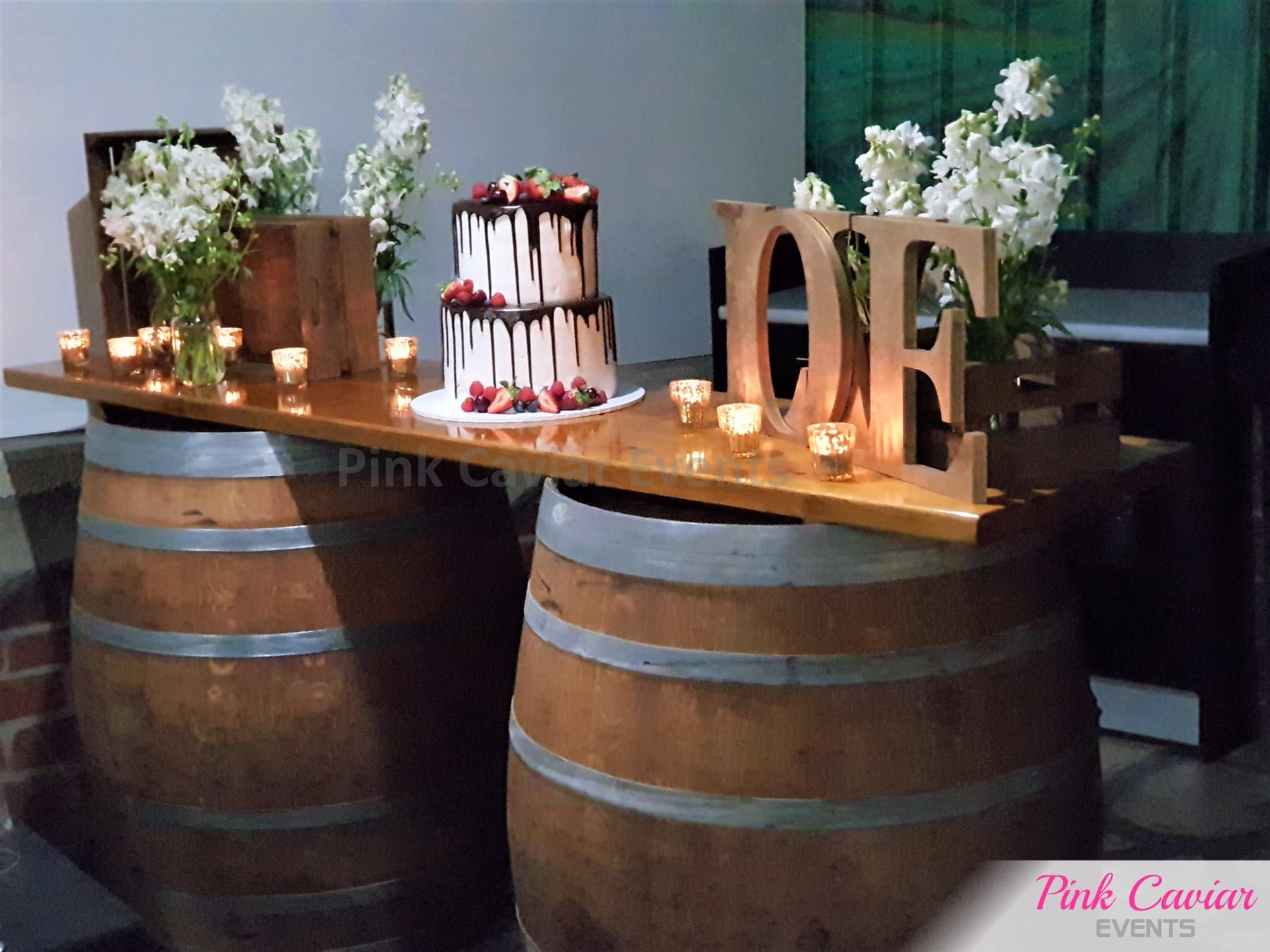 rustic barrel bar cake table engagement nakedcake chocolate tealight candles and love letters