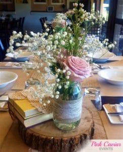 rustic style centrepiece timber slice mason jar flowers WM