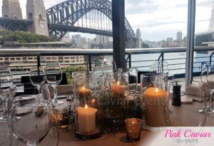 wedding centrepiece pillar candles and greenery sydney harbour bridge WM SMASH