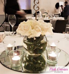 white flowers fishbowl arrangement mirror base tealights WM