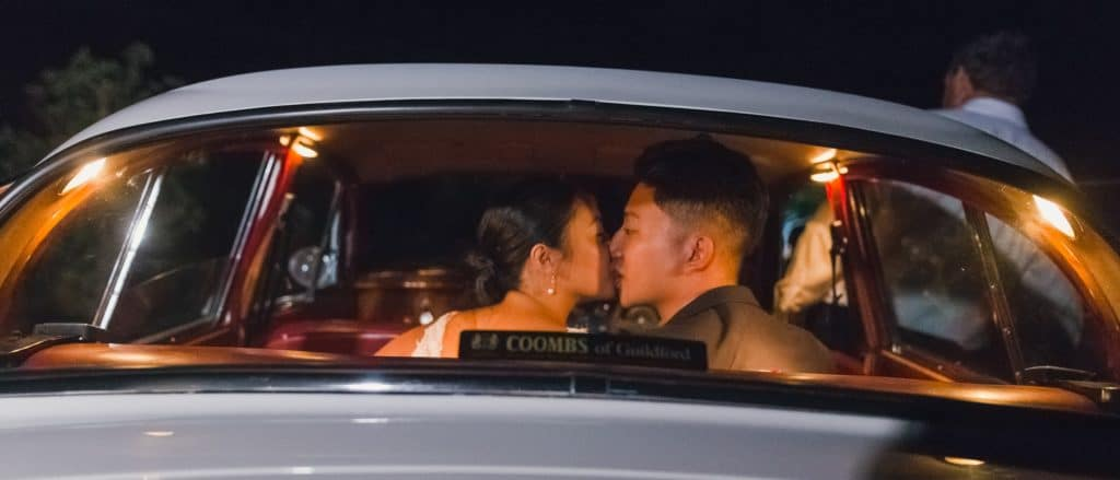 Wedding Couple Bride Groom Getaway Car Exit Kiss
