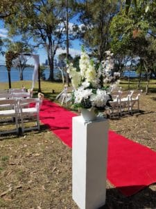 White Pedastal with Flowers at Outdoor Wedding Ceremony CHECEKED