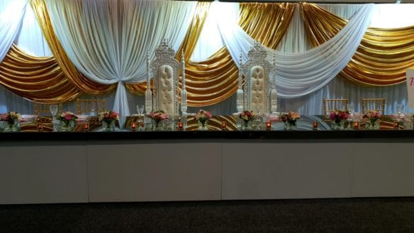 White Gloss Mirrored Top Bridal Table with white and gold backdrop and bridal thrones