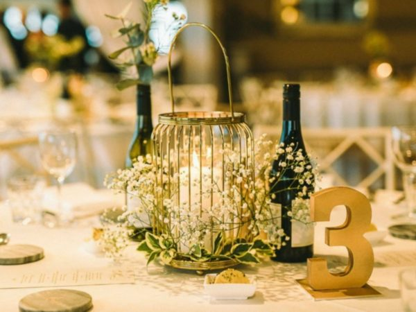 Gold Lantern with flowers and candle centrepiece
