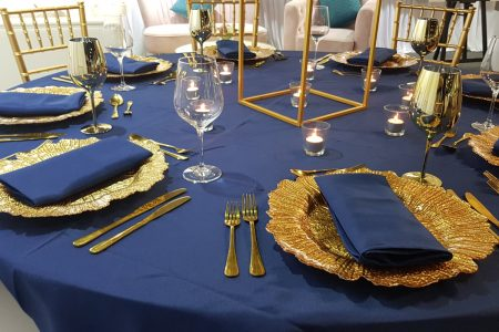 Gold Flared Charger Plate with Navy Napkin and Tablecloth