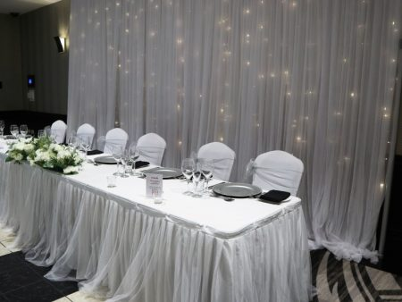 bridal table with skirting and fairy light backdrop