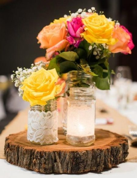 Seasonal Flowers on Rustic Timber Slice with Tealight