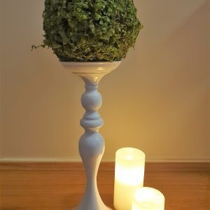 greenery ball on white stand with led candles