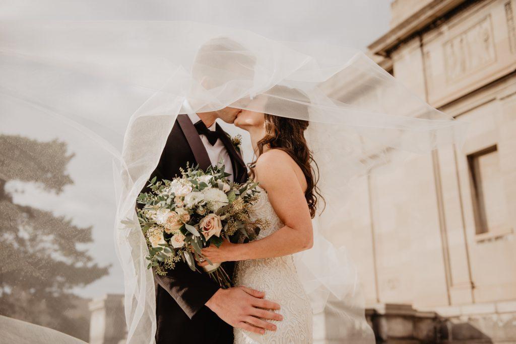 wedding couple bride and groom kiss