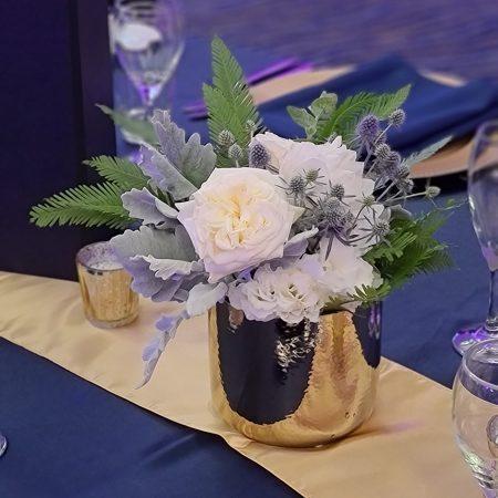 Flowers in gold vase