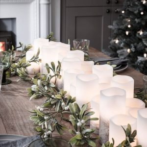 LED candles with greenery Christmas table runner